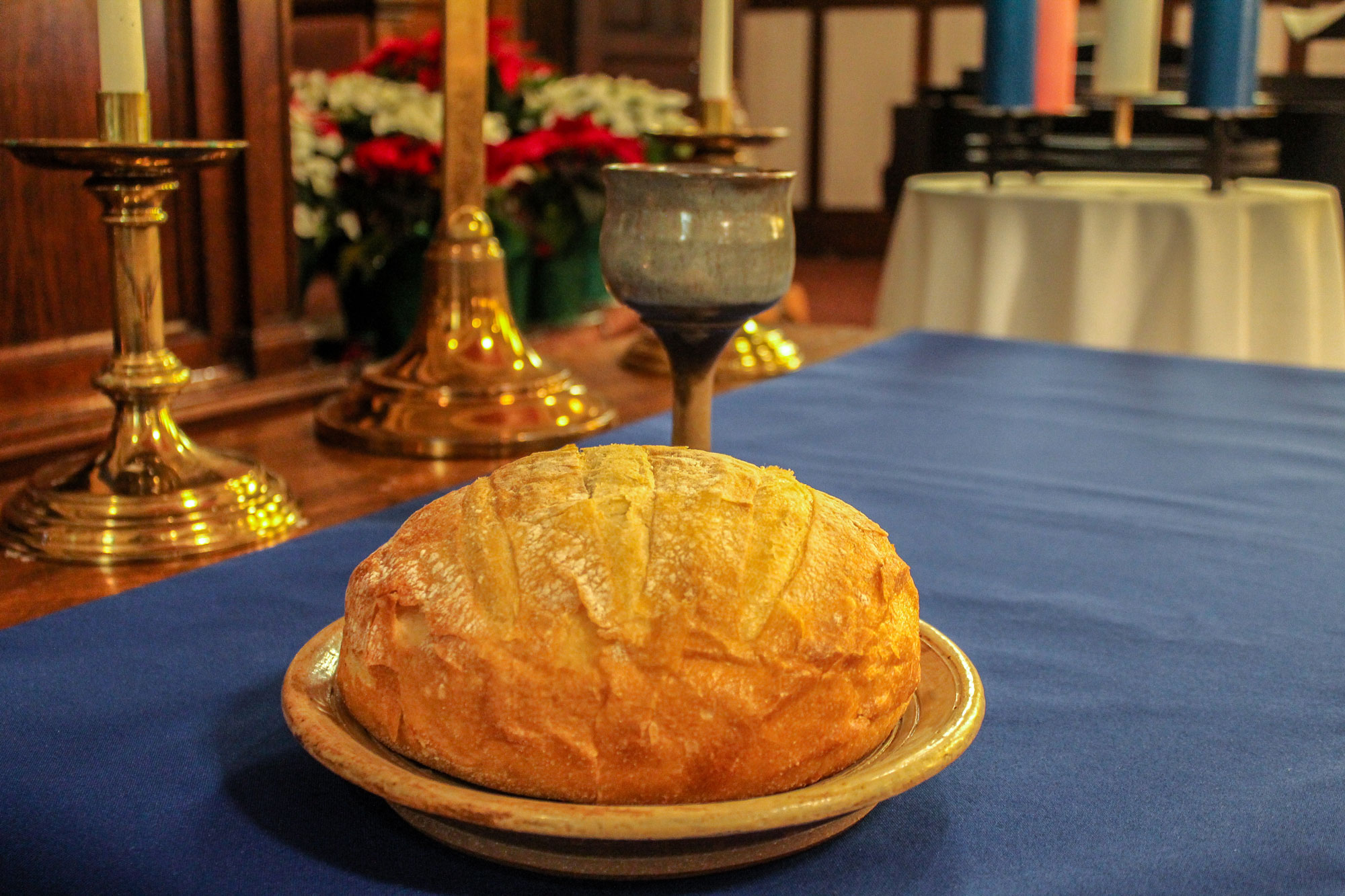 Communion bread at an open table